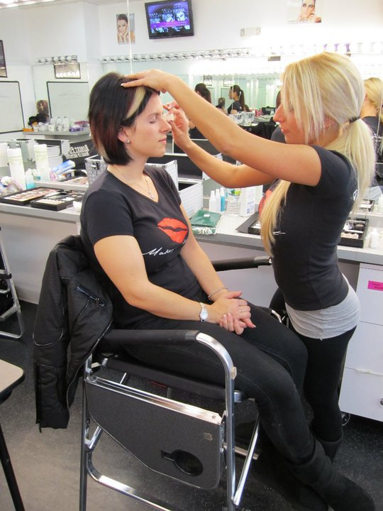 students practicing makeup